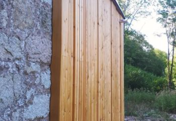 Extension en bois d'une maison en pierre bardage 1
